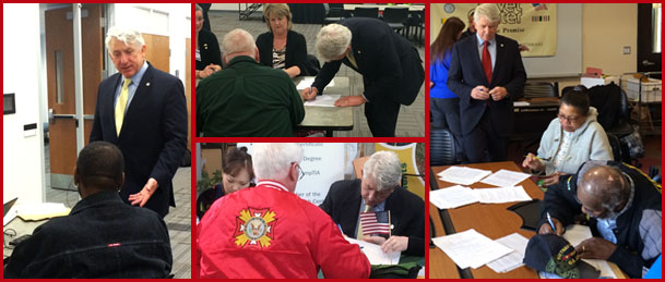 Veterans Legal Services Clinic pictures of the Attorney General Mark Herring signing wills and other legal documents for veterans that attended the clinic.